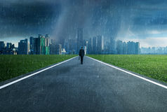 Business man walking in a storm,victory concept. royalty free stock photo