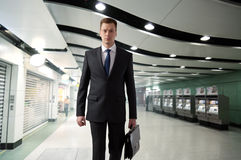 Business man in subway Stock Image
