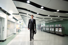 Business man walking in subway Royalty Free Stock Photography
