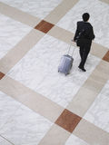 Business man walking with suitcase elevated view Royalty Free Stock Photo