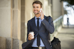 Business man walking talking on cell phone Royalty Free Stock Images