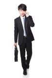 Business man Walking while talking phone Stock Photos