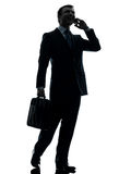 Business man walking on the telephone silhouette Royalty Free Stock Photography
