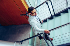 Business man walking to work. Business man on stairs Stock Photos