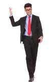 Business man walking towards you Royalty Free Stock Image