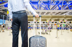 Business man walking travel bag by an international airport Stock Photography