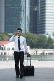 Business man walking and using a Cell Phone Stock Images