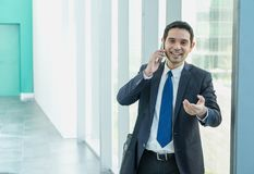 Business man walking and using mobile phone to chatting with fri royalty free stock photo