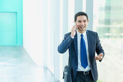 Business man walking and using mobile phone to chatting with fri Stock Photography
