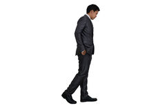 Business man walking on white background.  Royalty Free Stock Photos
