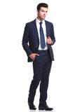 Business man walking on white studio background Royalty Free Stock Photos