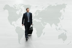 Business man walking the world map, international travel concept Royalty Free Stock Images