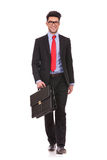 Business man walks forward with suitcase Stock Image