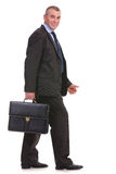 Business man walks with his briefcase Royalty Free Stock Photos