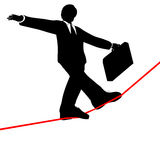 Business man walks risky high tightrope from below. A business man balances with a briefcase, walks a high wire tightrope, above risk and danger, view from below Stock Photo