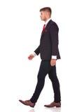 Business man walks sideway Stock Photos