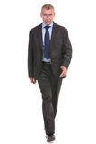Business man walks to you Royalty Free Stock Photography