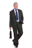 Business man walks toward the camera with briefcase Stock Photos