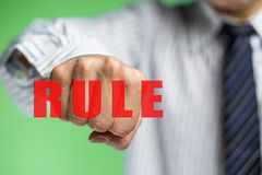 A business man want to break the rule Stock Photos