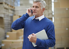 Business man in warehouse Stock Images