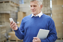 Business man in warehouse Stock Photos
