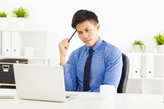 Business man watching laptop and thinking Stock Photography