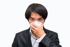 A business man wear Hygienic mask. For protect PM2.5 Dust on White background stock photography