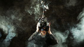 Business man wearing a brain-control helmet. Forced ideas extraction stock video