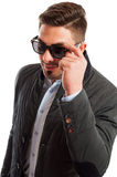 Business man wearing casual elegant holding his sunglasses Stock Photography