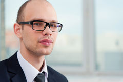 Business man wearing glasses in suit Royalty Free Stock Image