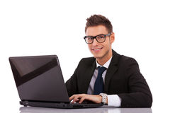 Business man wearing glasses  using a laptop Stock Photo