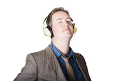 Business man wearing headphones on white Royalty Free Stock Photography