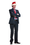 Business man wearing santa hat and standing  with hands crossed Royalty Free Stock Image