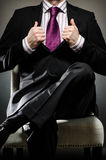 Business Man wearing suit. Image of business man sitting in chair Stock Images
