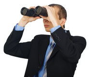 Business man wearing suit with blue tie with binoculars Stock Photography
