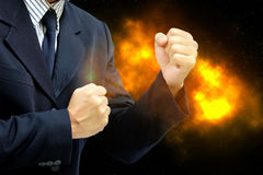 Business Man wearing a suit fists ready to fight. The concept of business competition is fierce as fire stock image