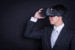 Business man wearing suit playing virtual reality goggles royalty free stock image