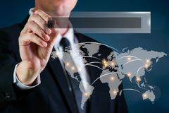 Business man with a web search bar and world map stock image