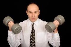 Business man with weights Stock Images