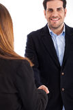 Business man welcomed by women man on focus Stock Image
