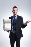 Business man welcomes you with books Royalty Free Stock Photo