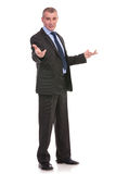 Business man welcomes you with hands opened Stock Photos