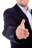 Business man welcomes you with open hand Royalty Free Stock Image
