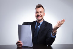 Business man welcomes you with papers Stock Photos