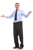 Business man welcomes you with a smile Royalty Free Stock Photography