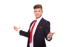 Business man welcomes you. Young business man welcoming you with his arms wide opened and looking at the camera. isolated on white background Stock Photography