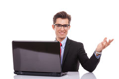 Business man welcoming at his desk Royalty Free Stock Image
