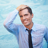 Business man with wet clothing in water Stock Images
