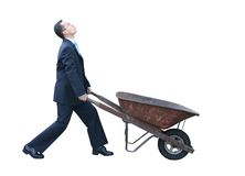 Business man with wheelbarrow Stock Images