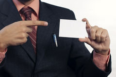 Business man with white card. Business man showing with finger  white card on white background Royalty Free Stock Photo
